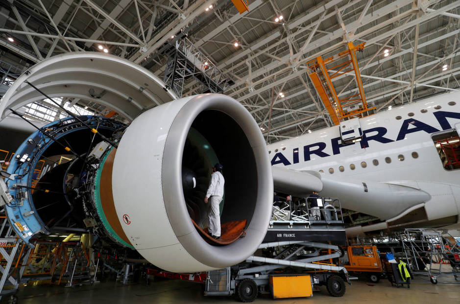 an-employee-works-on-an-airbus-a380-plane-inside-the-air-france-klm-maintenance-hangar-at-the-charles-de-gaulle-international-airport-in-roissy-near-paris-france-may-31-2016-reuters-philippe-wojazer